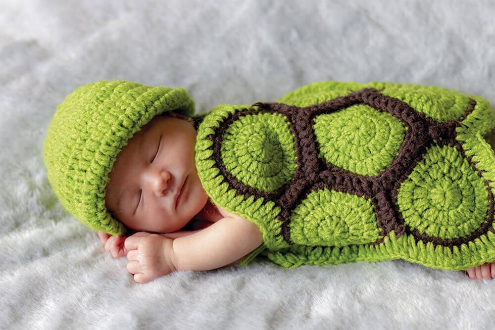 Fotografía de recien nacido con un disfraz